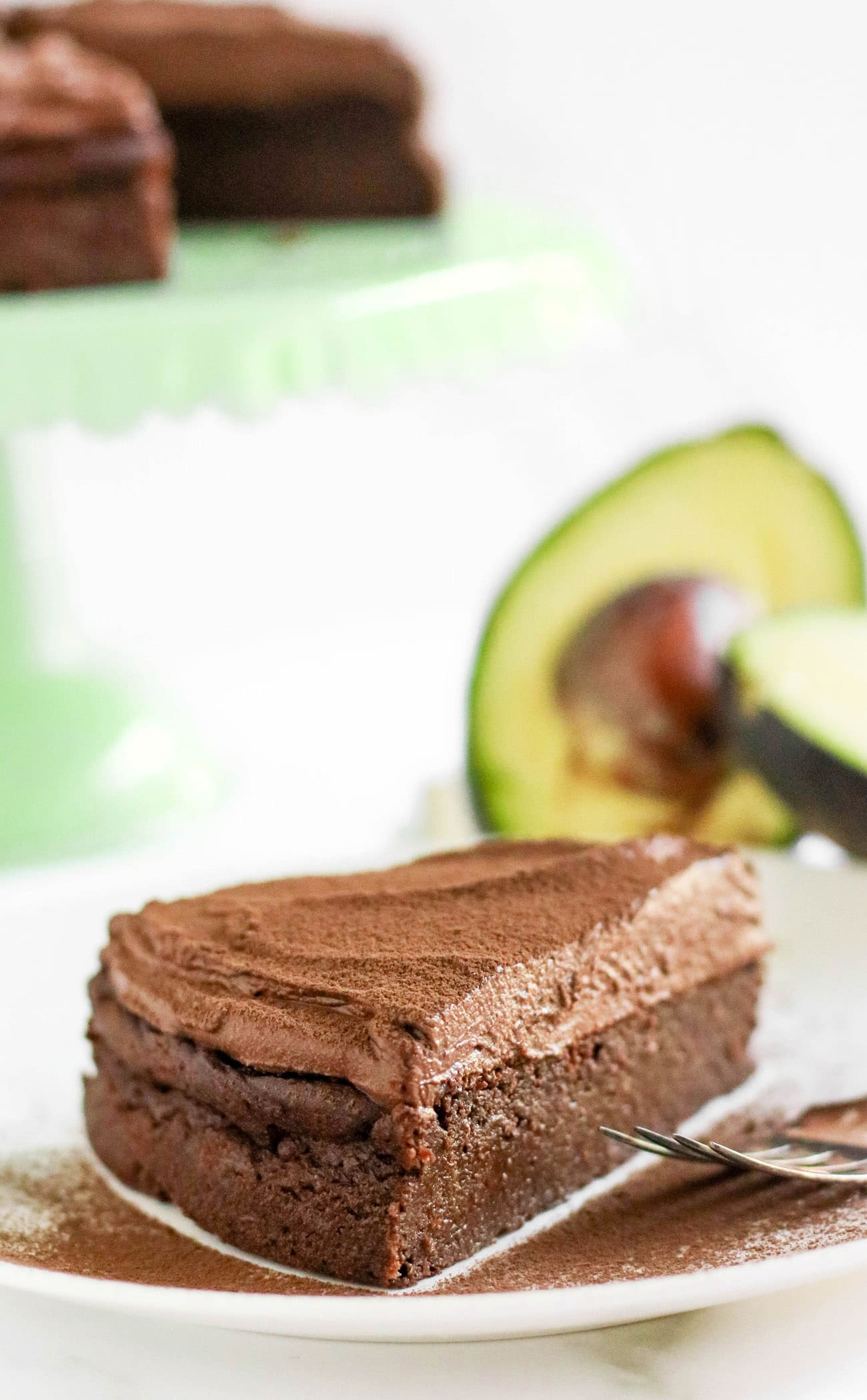 This healthier Chocolate Avocado Cake is super chocolatey, perfectly sweet, and nutritionally balanced with healthy fats, whole grains, lots of fiber, and a hit of protein! It's just as rich, and chocolatey as classic chocolate cake, except this is made without the butter, oil, regular white sugar, and bleached flour!