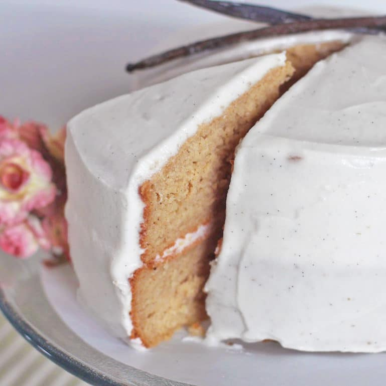 This Healthy Gluten-Free Vanilla Bean Cake is super moist and topped with a sweet and Vanilla Bean Frosting, it doesn't taste low fat and sugar free at all!