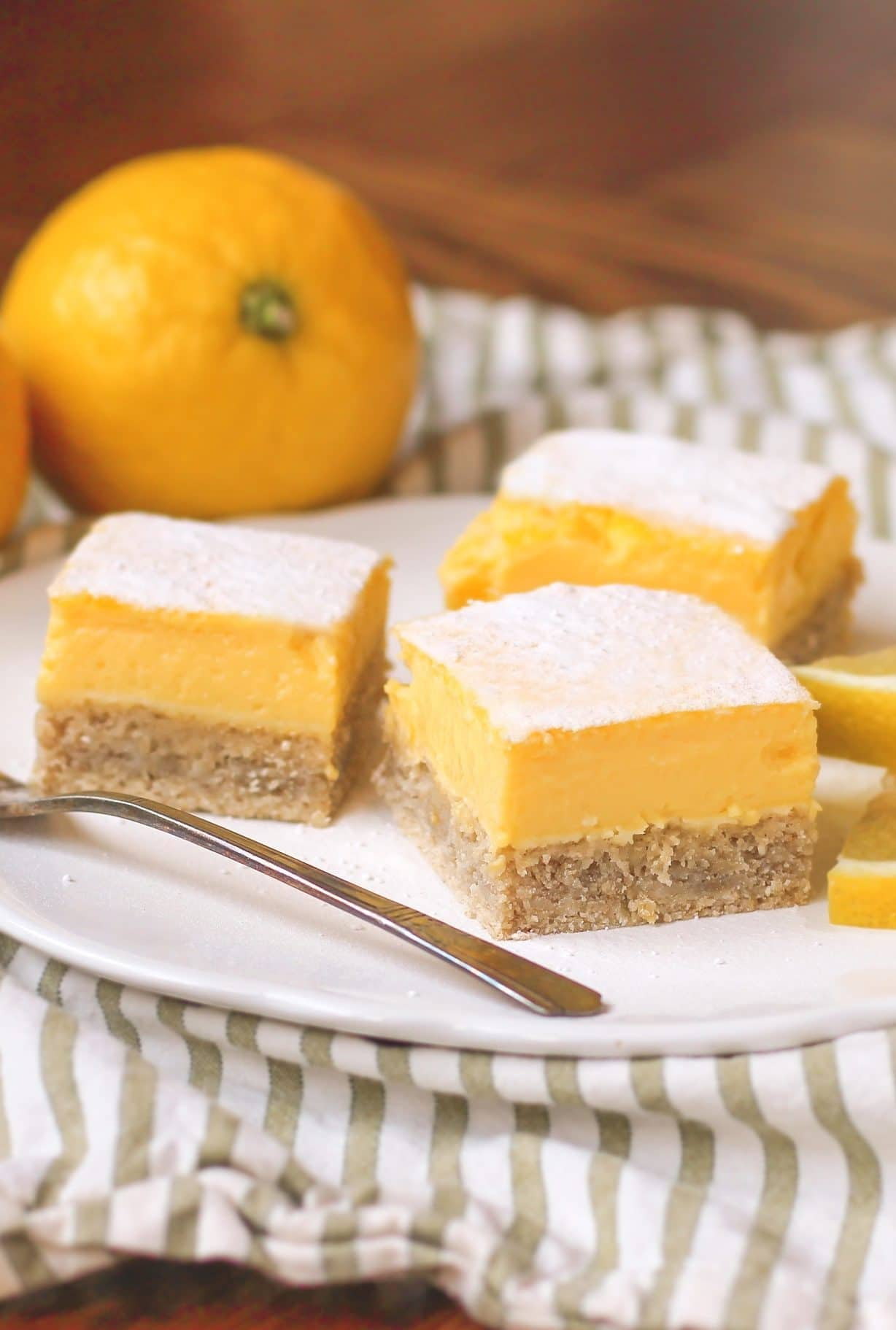 These delicious Lemon Bars are made without any sugar, butter, and flour, but they're just as tart and sweet as the original! You'd never know they're sugar free, gluten free, dairy free, and high protein too!