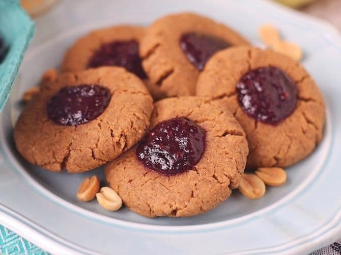 These Healthy Peanut Butter and Jelly Thumbprint Cookies are soft, chewy and delicious. You'd never they're sugar free, high protein, gluten free and vegan! -- Healthy Dessert Recipes at Desserts with Benefits