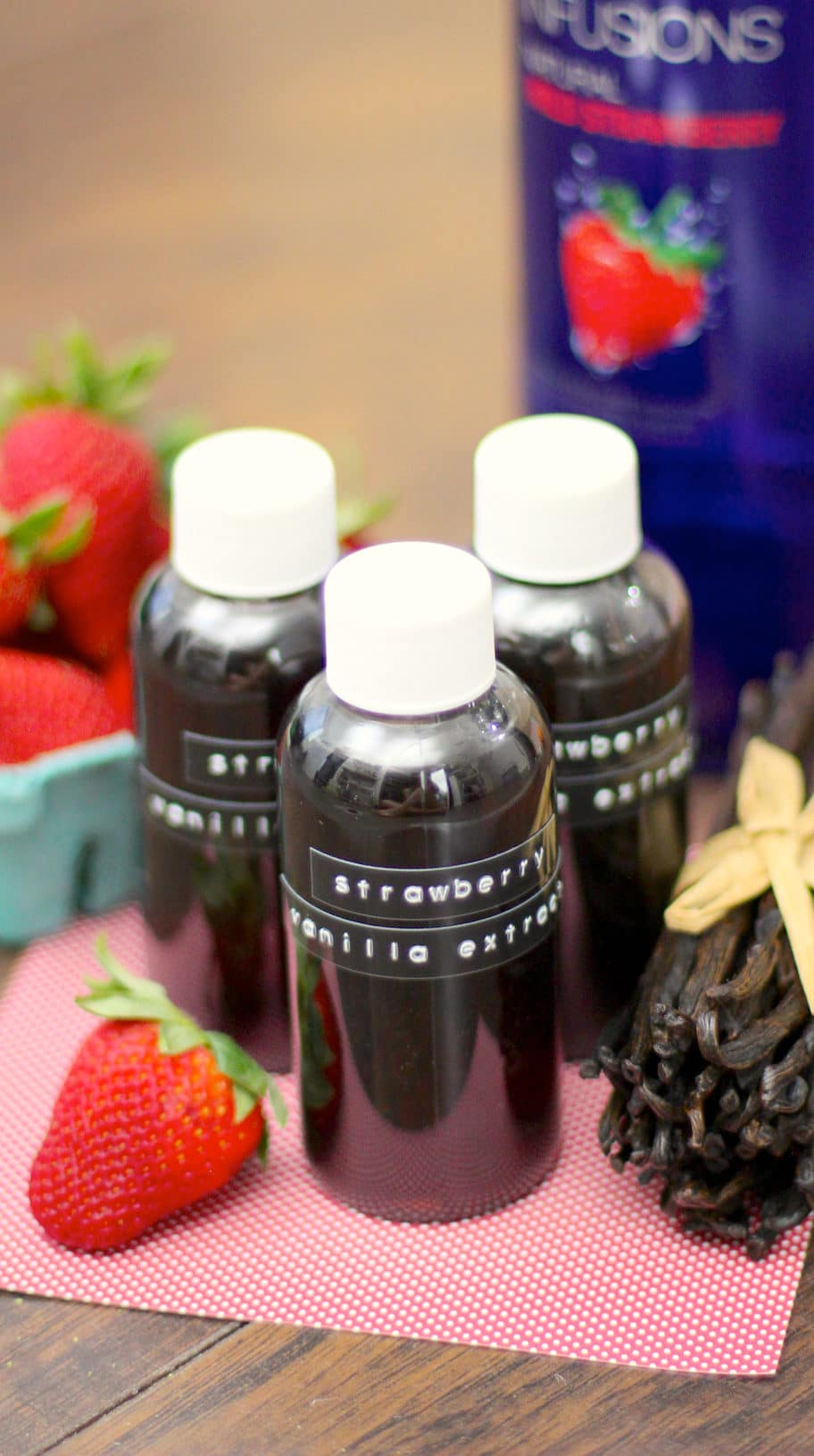 Do you ever wish Vanilla Extract had a little more oomph? Well, now it does! This super easy, 2-ingredient strawberry-infused homemade Vanilla Extract is perfect for cakes, frostings, ice creams and more!
