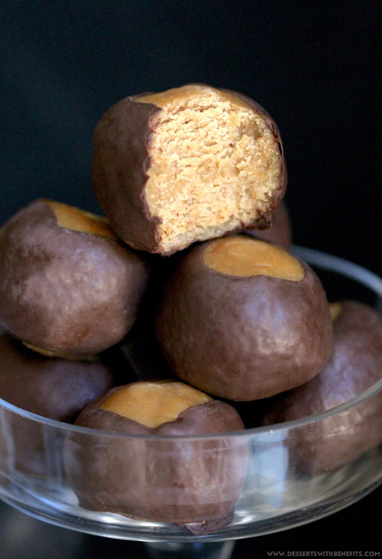 These Healthy Buckeye Balls are sweet and fudgy, peanut buttery orbs of magic surrounded by a layer of rich and decadent dark chocolate. It's hard to believe they're refined sugar free, low carb, high protein, and gluten free! Healthy Dessert Recipes at Desserts with Benefits