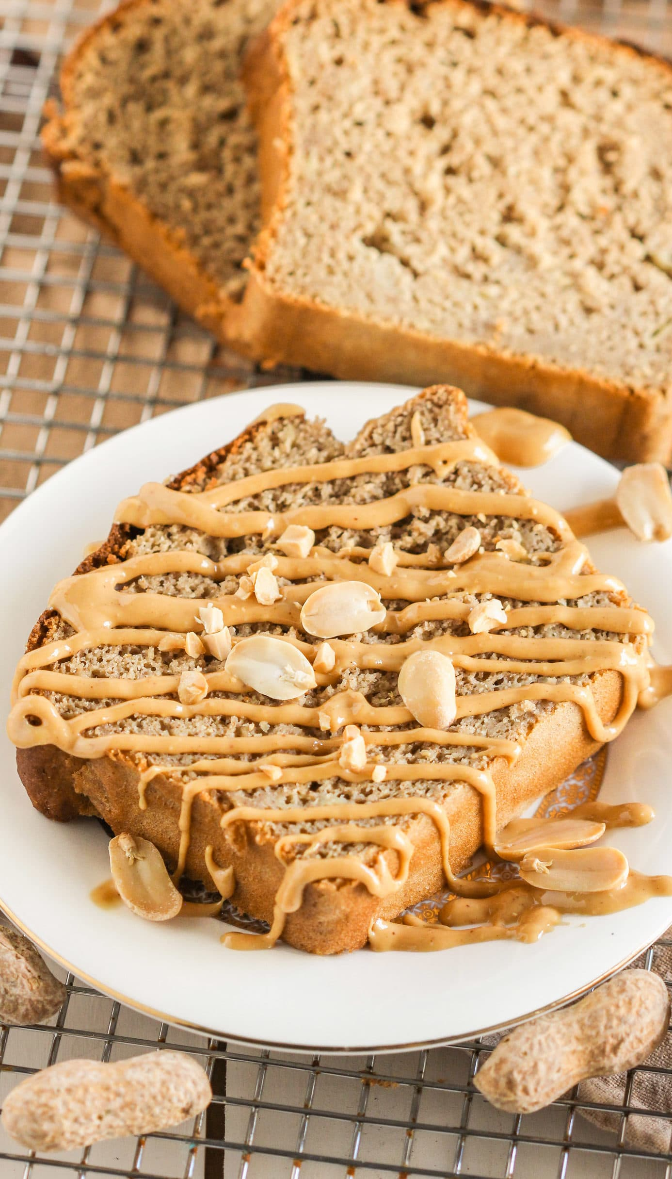 This is the BEST Healthy Peanut Butter Banana Bread EVER! It's so rich, moist, and flavorful, one bite and you'll wonder how there's no butter and no sugar added. Yes, this bread is refined sugar free, gluten free, AND high protein! Healthy Dessert Recipes with low calorie, low fat, low carb, gluten free, dairy free, vegan, and raw options at the Desserts With Benefits Blog (www.DessertsWithBenefits.com)