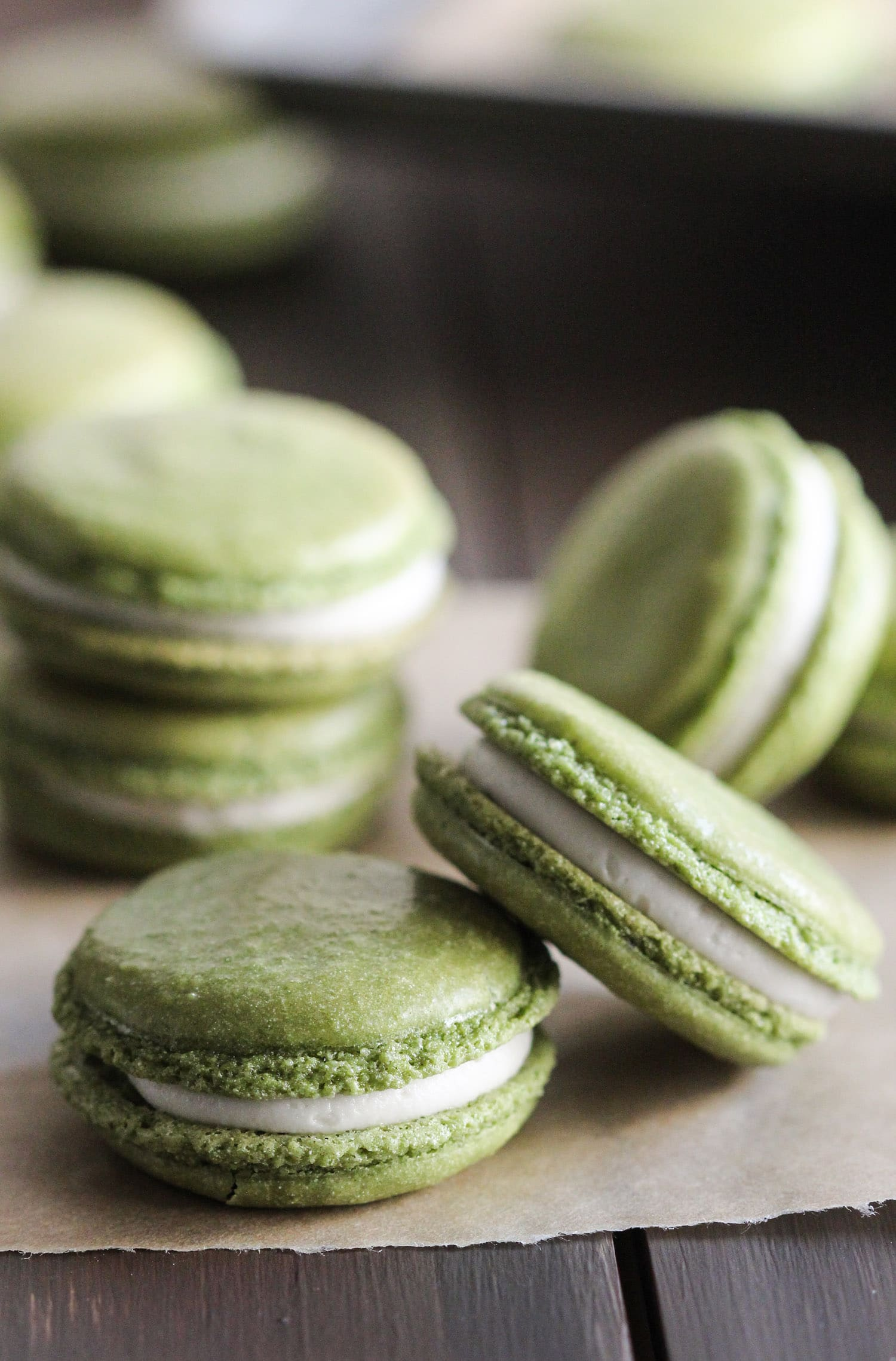 These Healthy Matcha Green Tea French Macarons aren't your typical macarons... these are made without the bleached white sugar, artificial flavorings, and artificial food dyes! That vibrant green you see is ALL NATURAL. These bite-sized treats are sweet, addicting, unique, and sophisticated. They're all natural, low fat, and gluten free too! Healthy Dessert Recipes at the Desserts With Benefits Blog