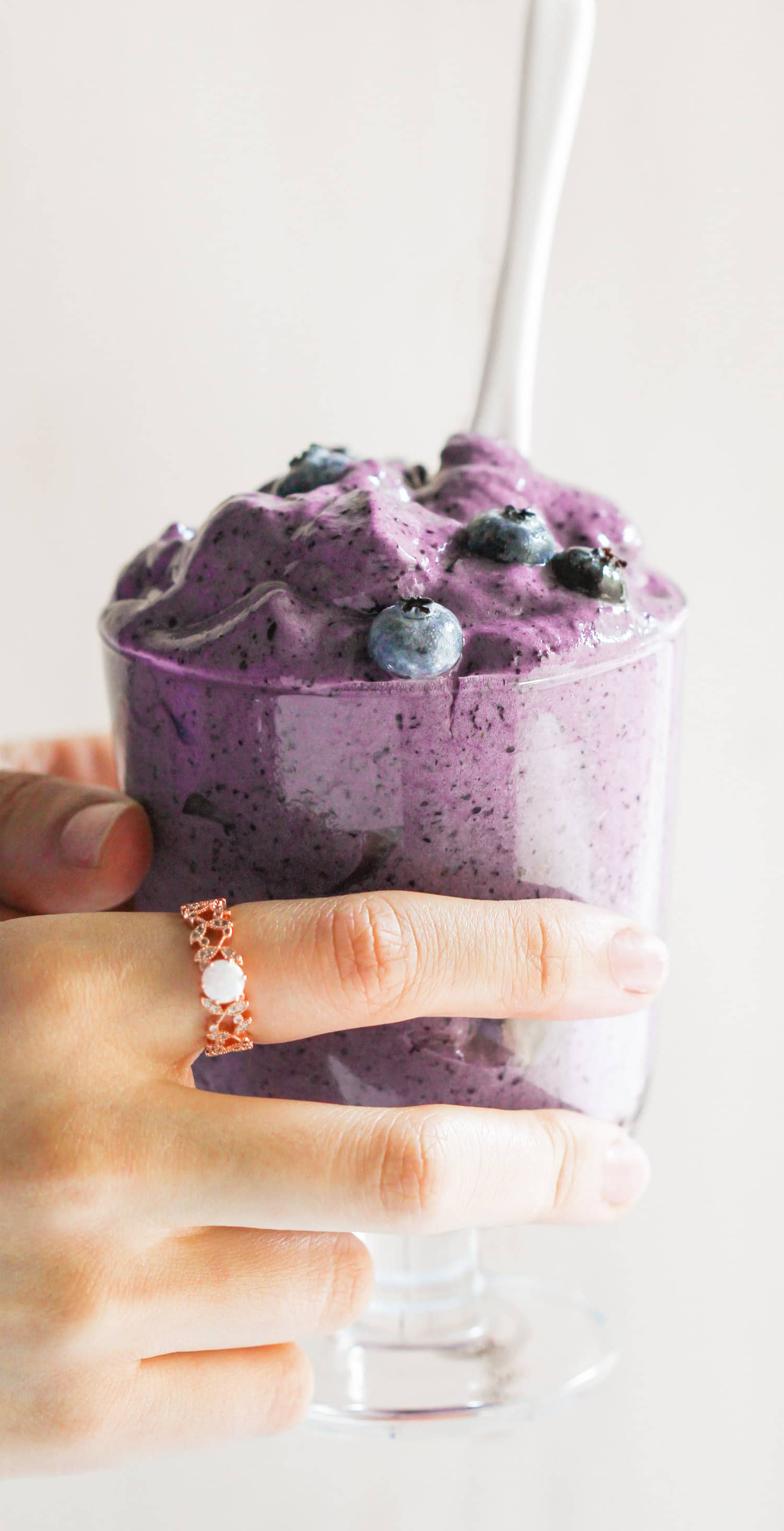 This Healthy Blueberry Protein Fluff is like a mixture between ice cream, whipped cream, and a cloud. So fluffy and voluminous with only 80 calories per serving. Plus, it's refined sugar free, low fat, high protein, and eggless! Healthy Dessert Recipes with sugar free, low calorie, low fat, low carb, high protein, gluten free, dairy free, vegan, and raw options at the Desserts With Benefits Blog (www.DessertsWithBenefits.com)