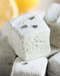 These Healthy Lemon Lavender Marshmallows are sweet, bright, refreshing, and delicious. They're like light and fluffy clouds of lemon-lavender goodness! Unlike storebought mallows, these are naturally flavored and naturally sweetened (no corn syrup or artificial ingredients here!). Healthy Dessert Recipes at the Desserts With Benefits Blog (www.DessertsWithBenefits.com)
