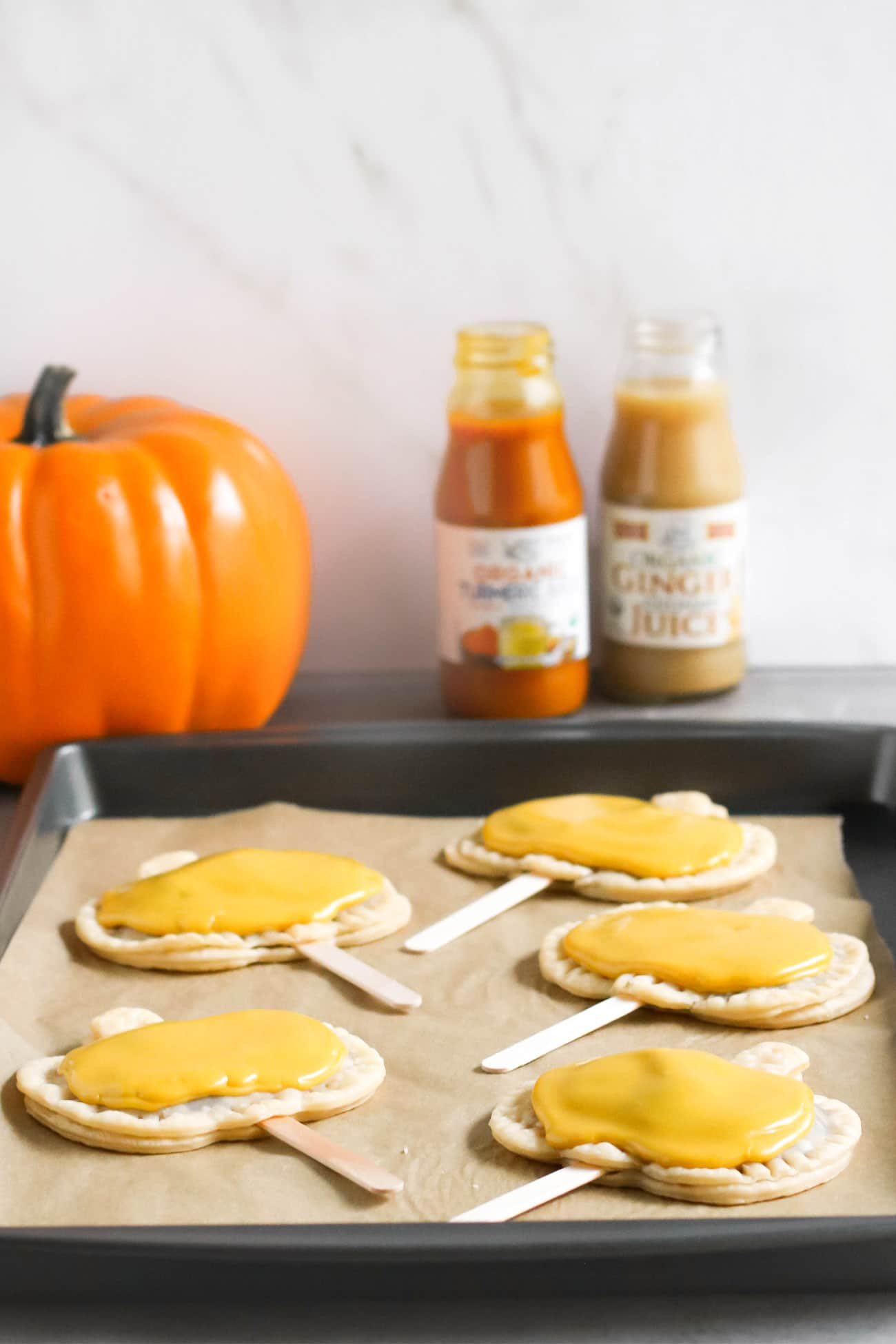 Pumpkin Pie Pops -- where Pumpkin Pie meets limited edition Pumpkin Pie Pop Tarts meets secretly good-for-you deliciousness! They're rich and sweet to satisfy your sweet tooth, and they're secretly vegan, dairy free, and lowsugar too! What can be better than homemade pumpkin pie filling all wrapped up in a flavorful pie crust? Everything about these screams Fall, Halloween, cool weather, fuzzy sweaters, and good feels. These are a guaranteed crowdpleaser, and definitely a dessert to impress!